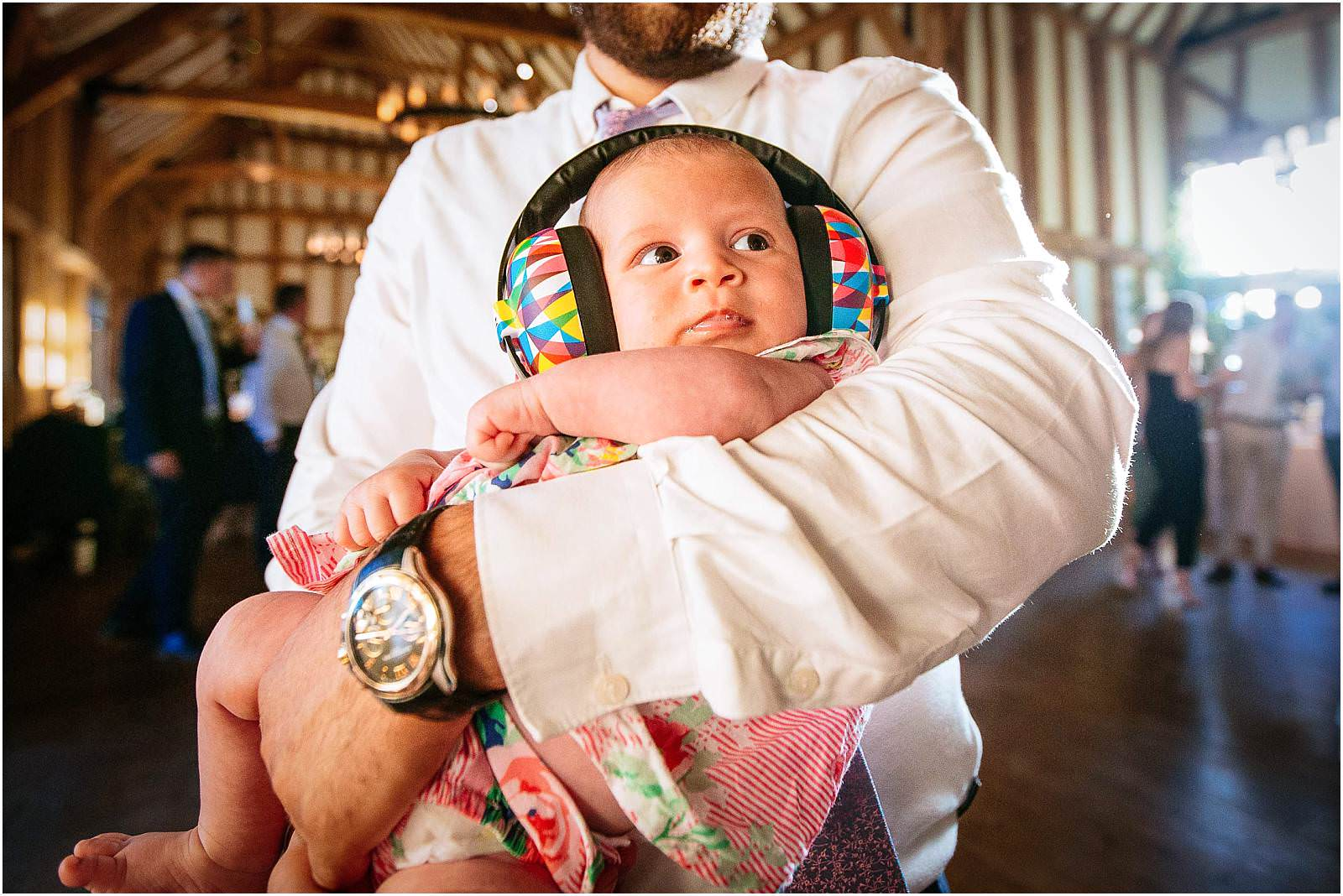 baby with ear defenders at