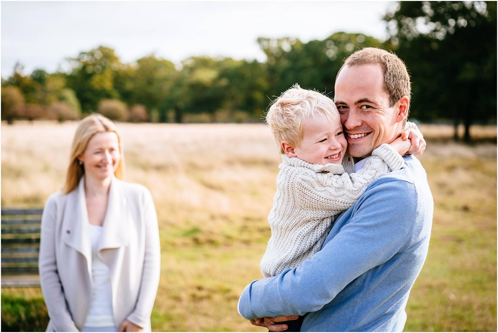 Smiling family in bushy park