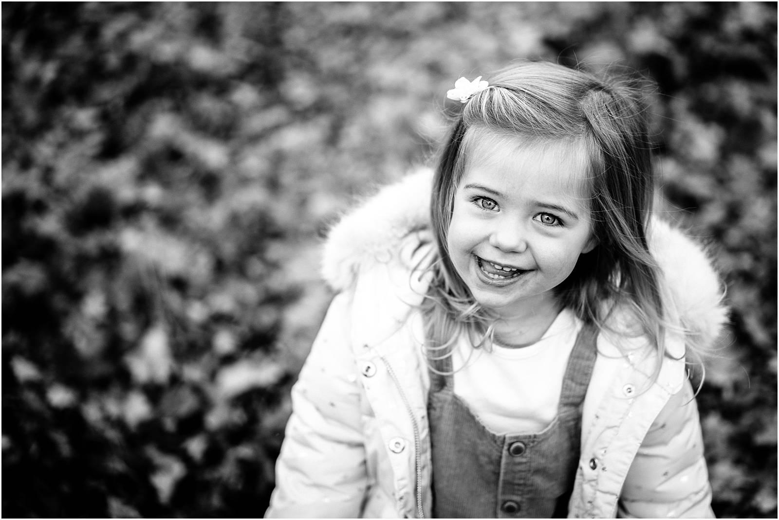 Cute girl in autumn woods Windsor park