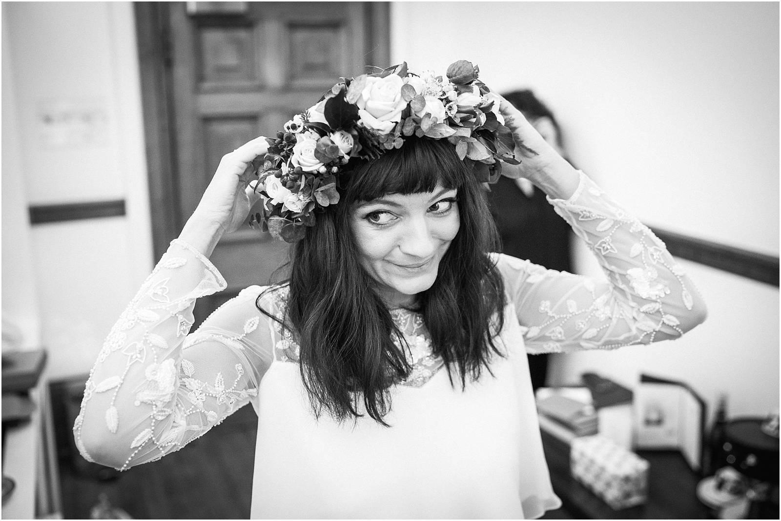 gorgeous bride adjusts flower crown