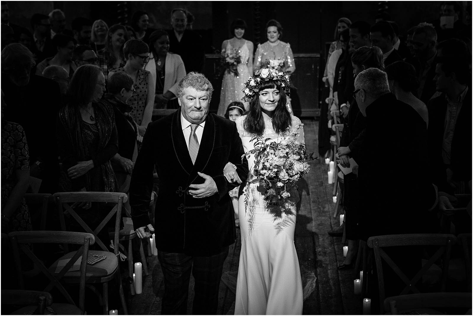 walking down aisle in black and white