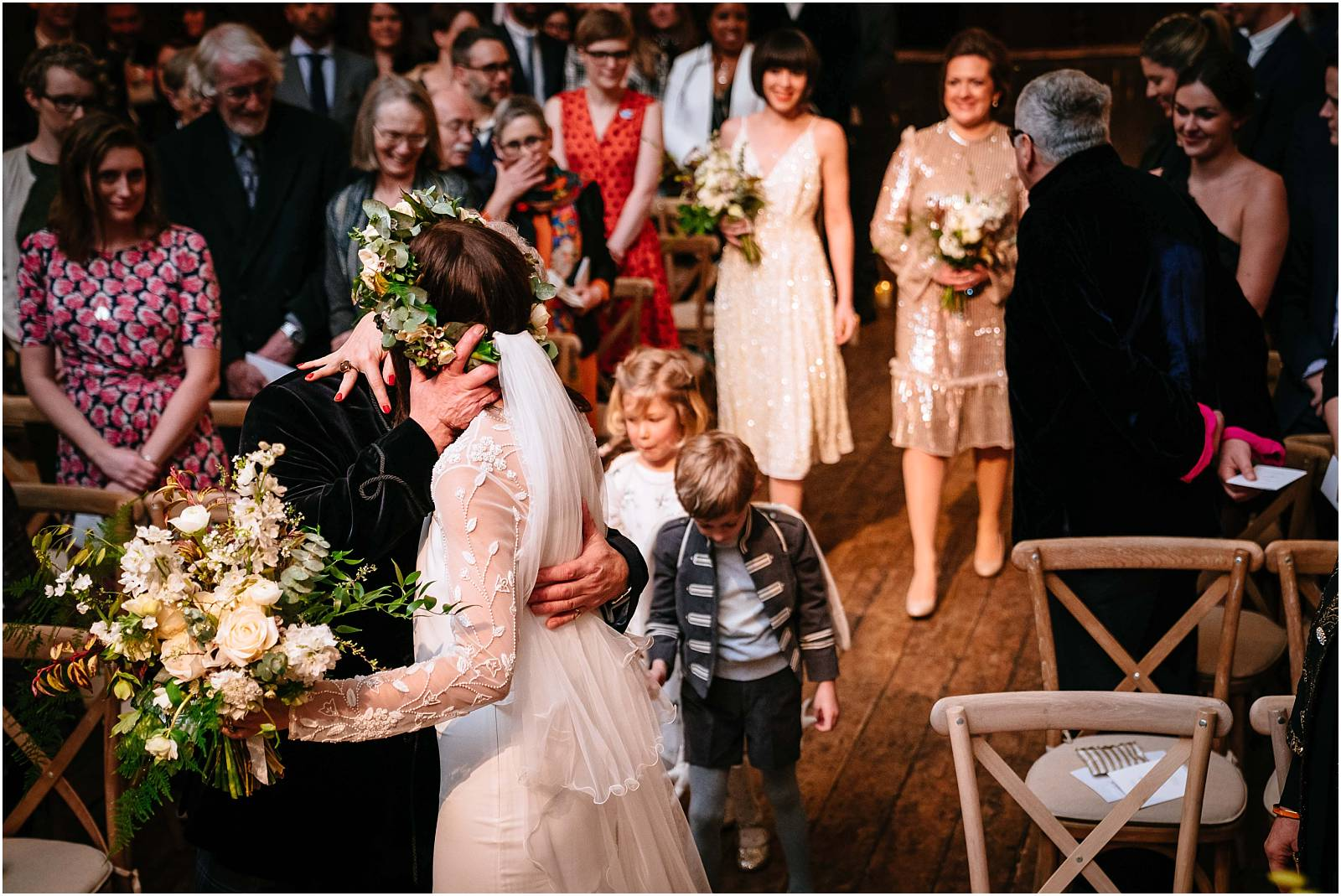 a kiss for dad at the end of the aisle