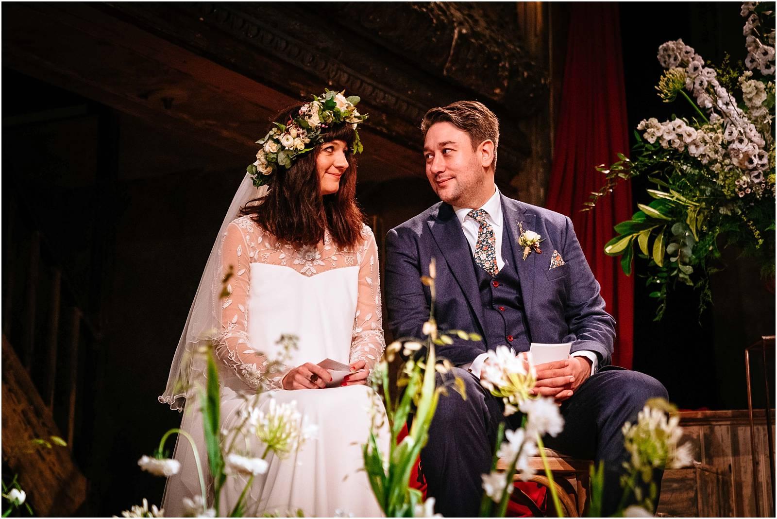 bride and groom exchange glance during london wedding ceremony