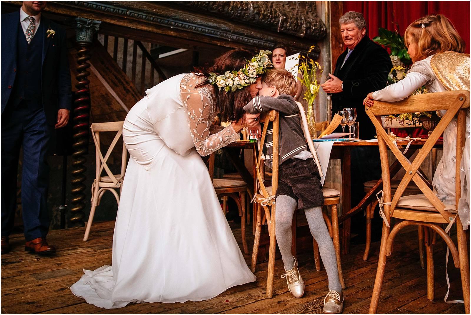 bride kisses son