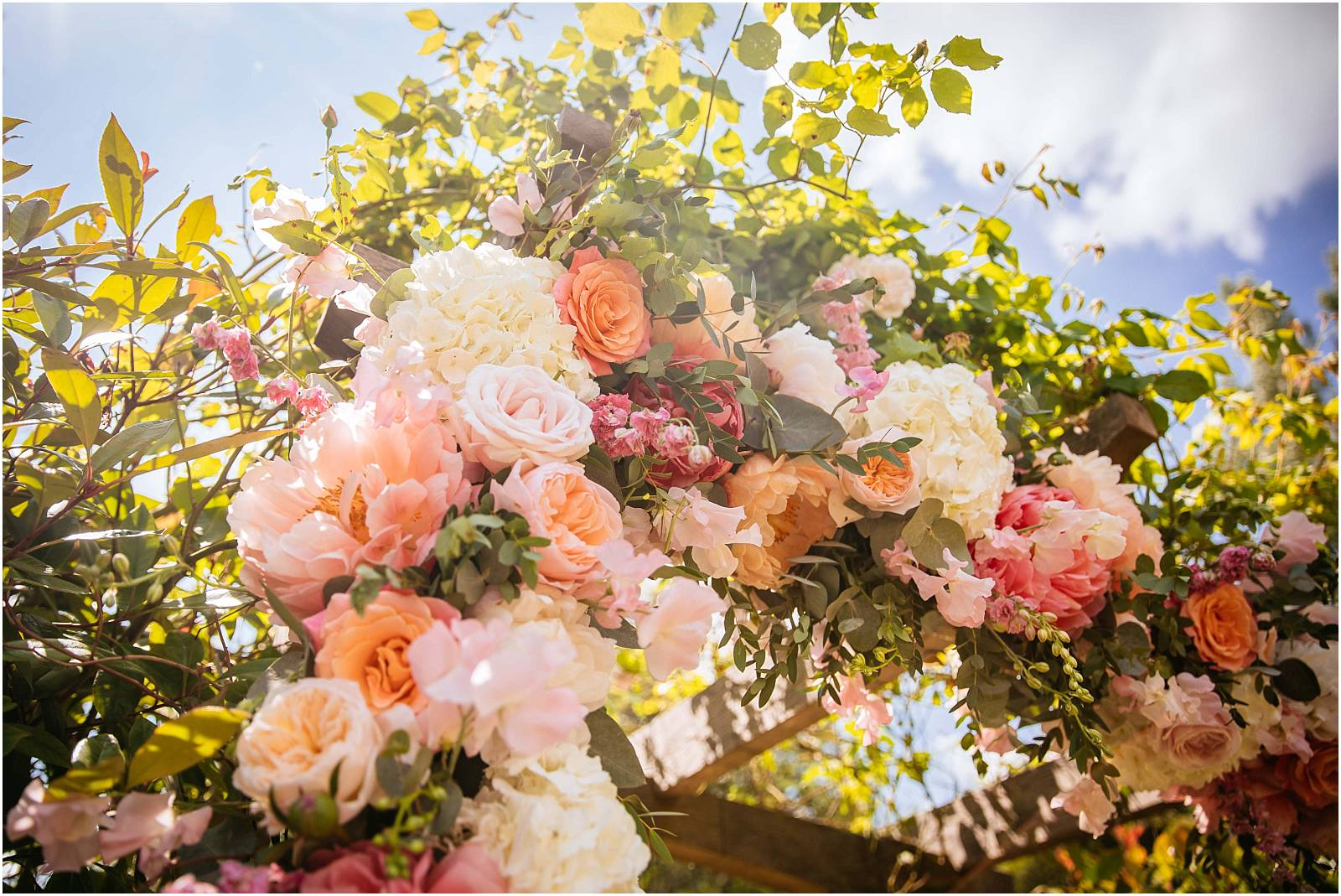 stunning peach floral arch at millbridge court