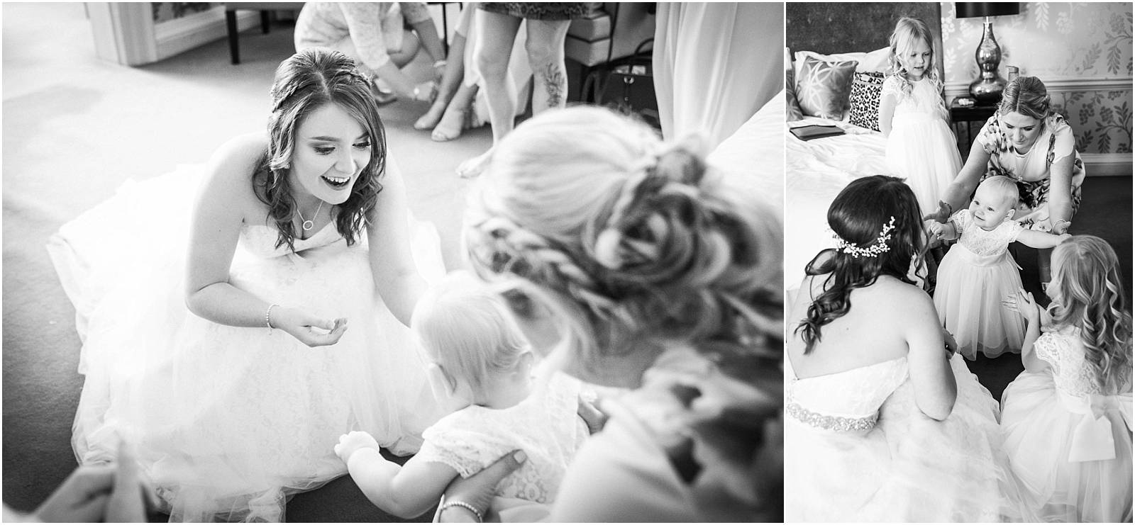 bride greeting baby in black and white