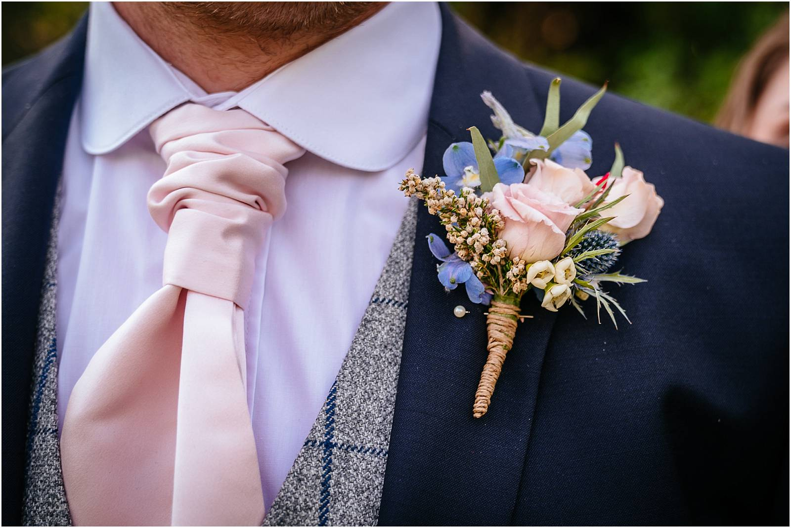 pink and blue groom button hole