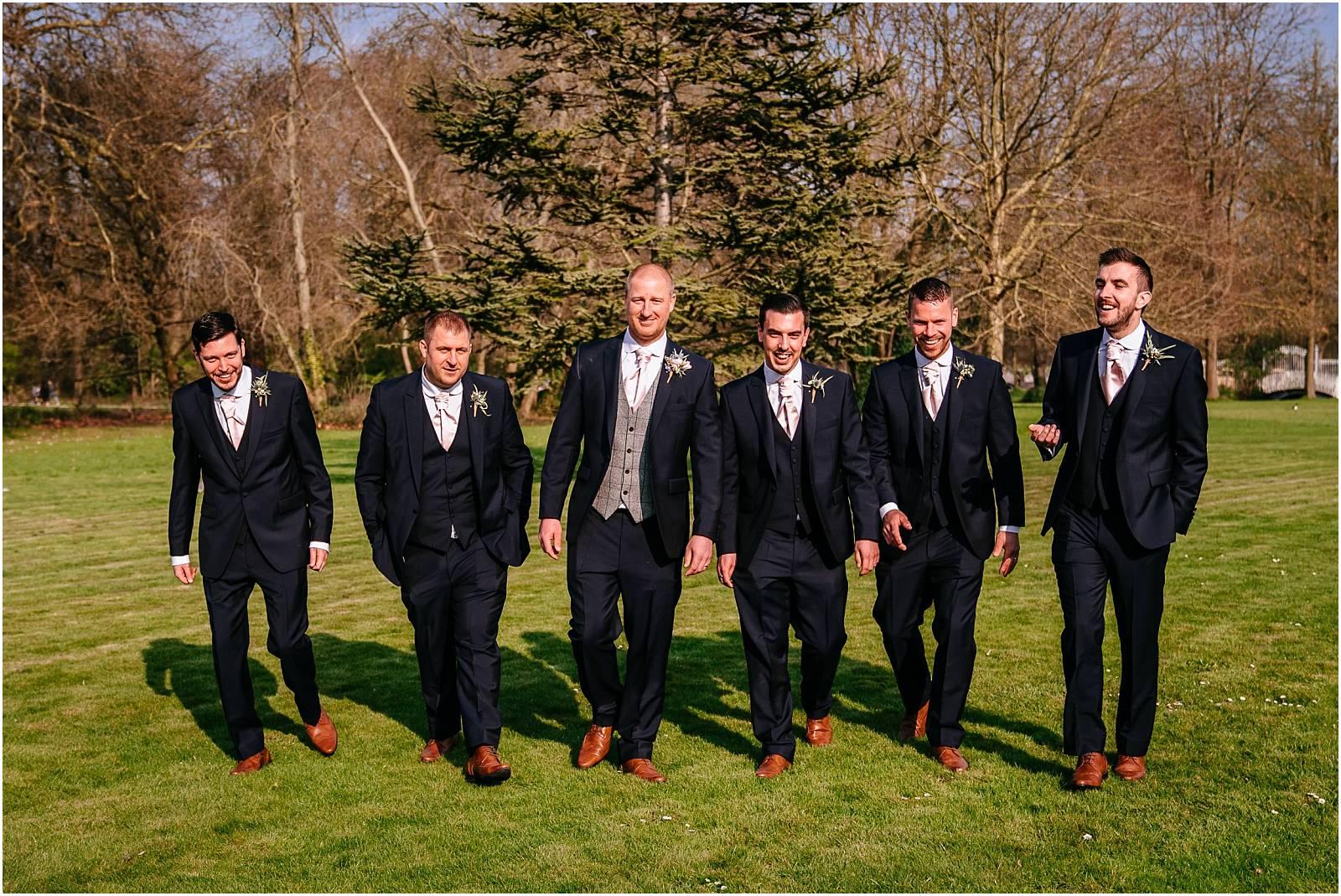 ushers walking with groom