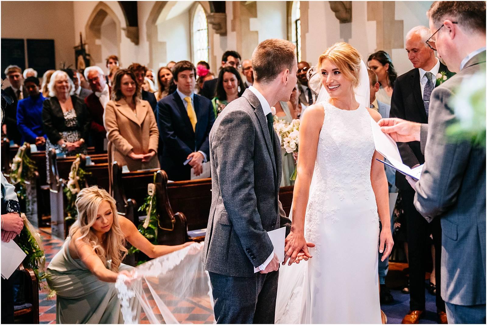 bride grins at groom