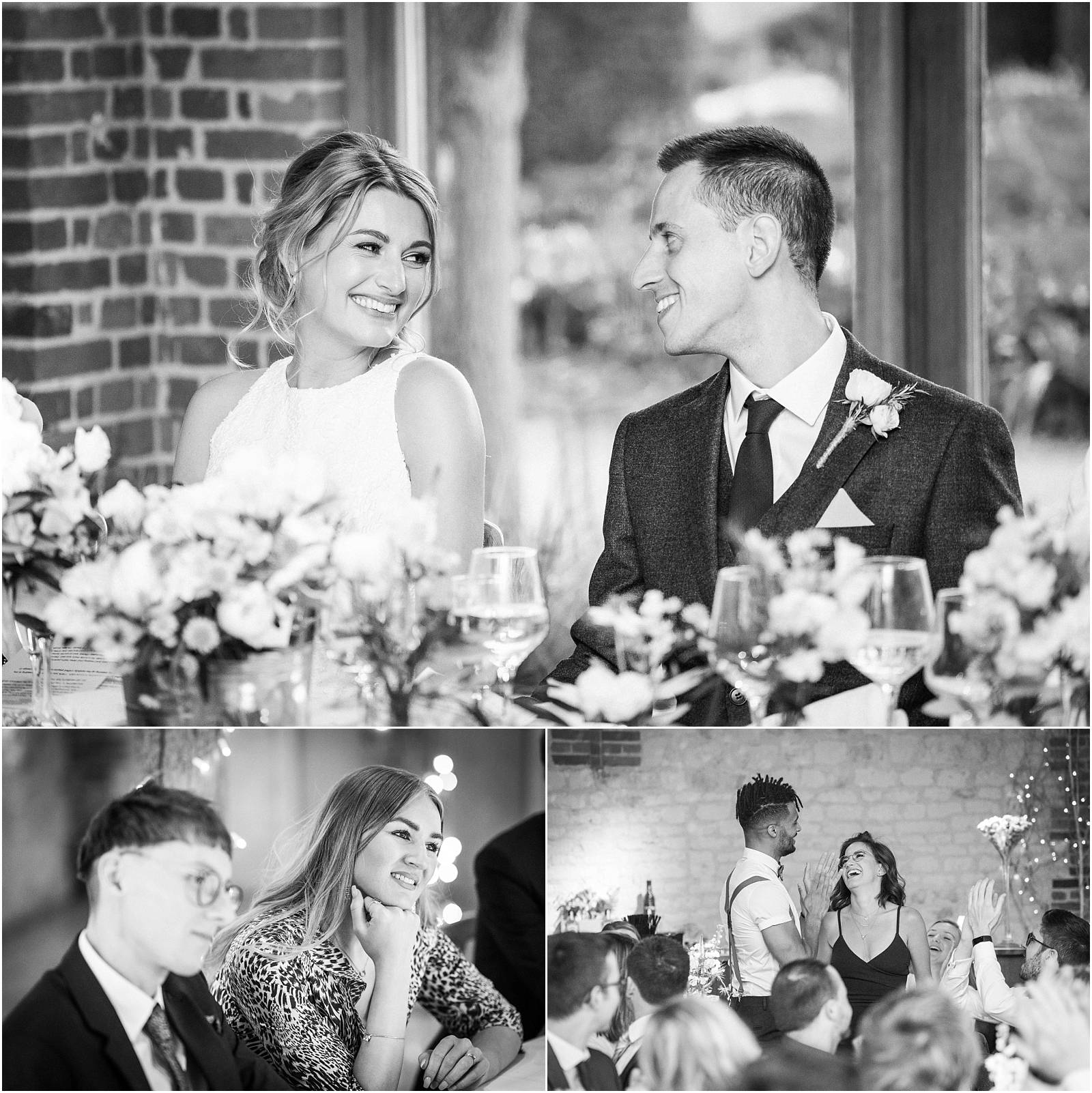 bride and groom share a glance during wedding speeches