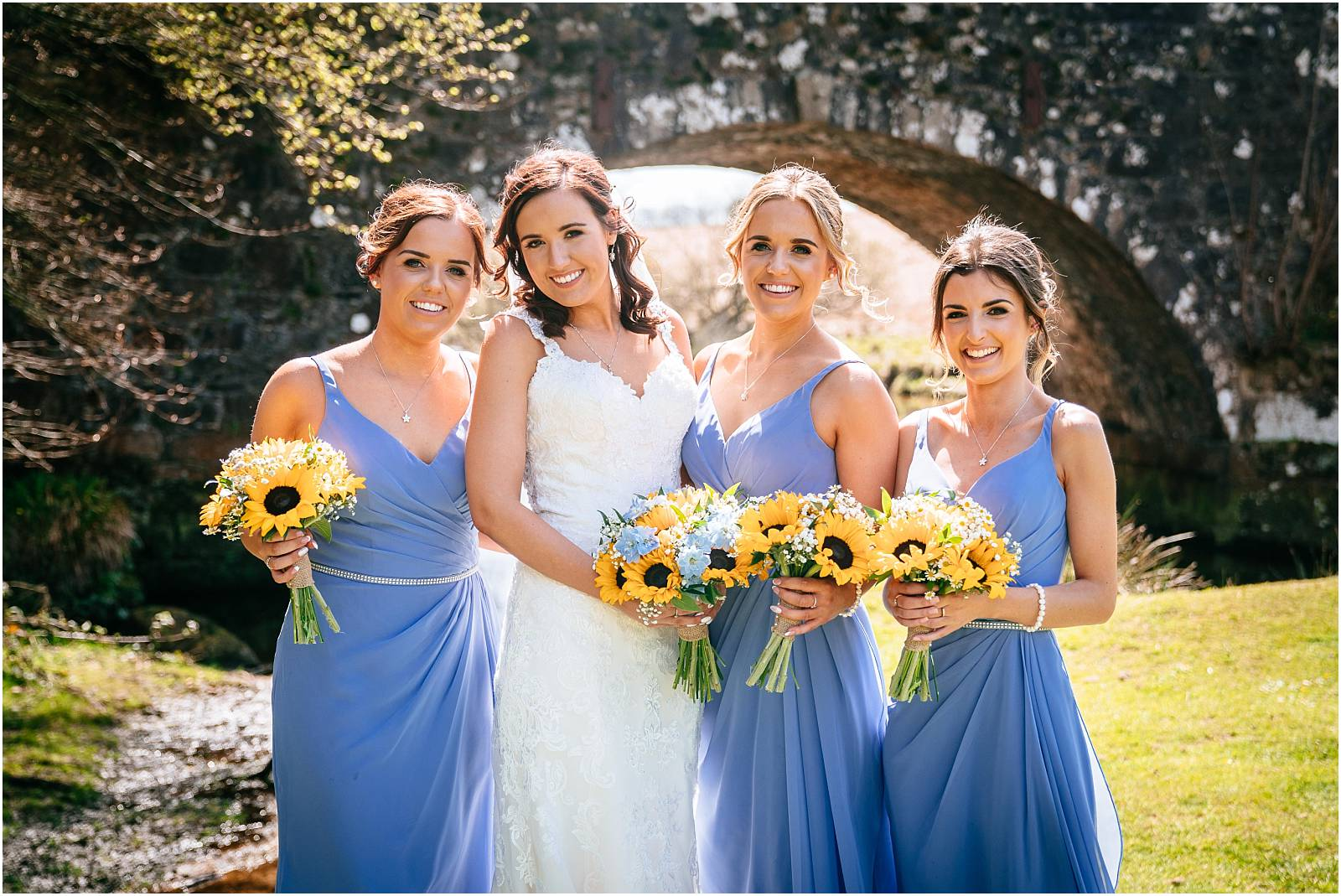 bridesmaids with sunflower bouquets at wedding