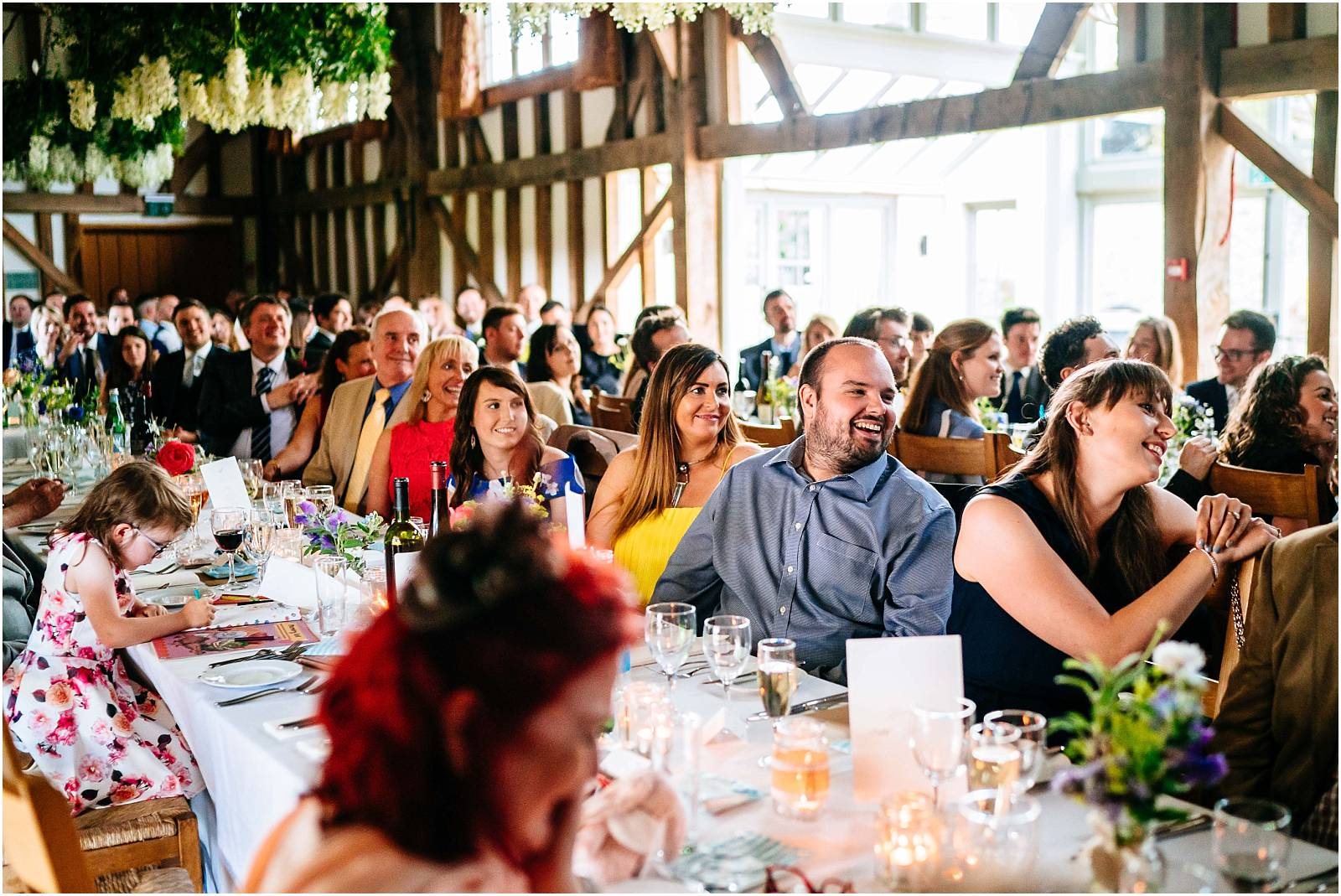 guests laugh during speeches