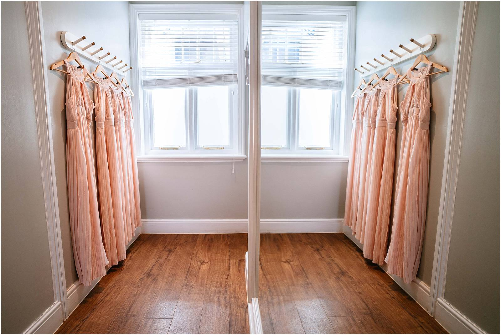 pink bridesmaid dresses reflected in mirror