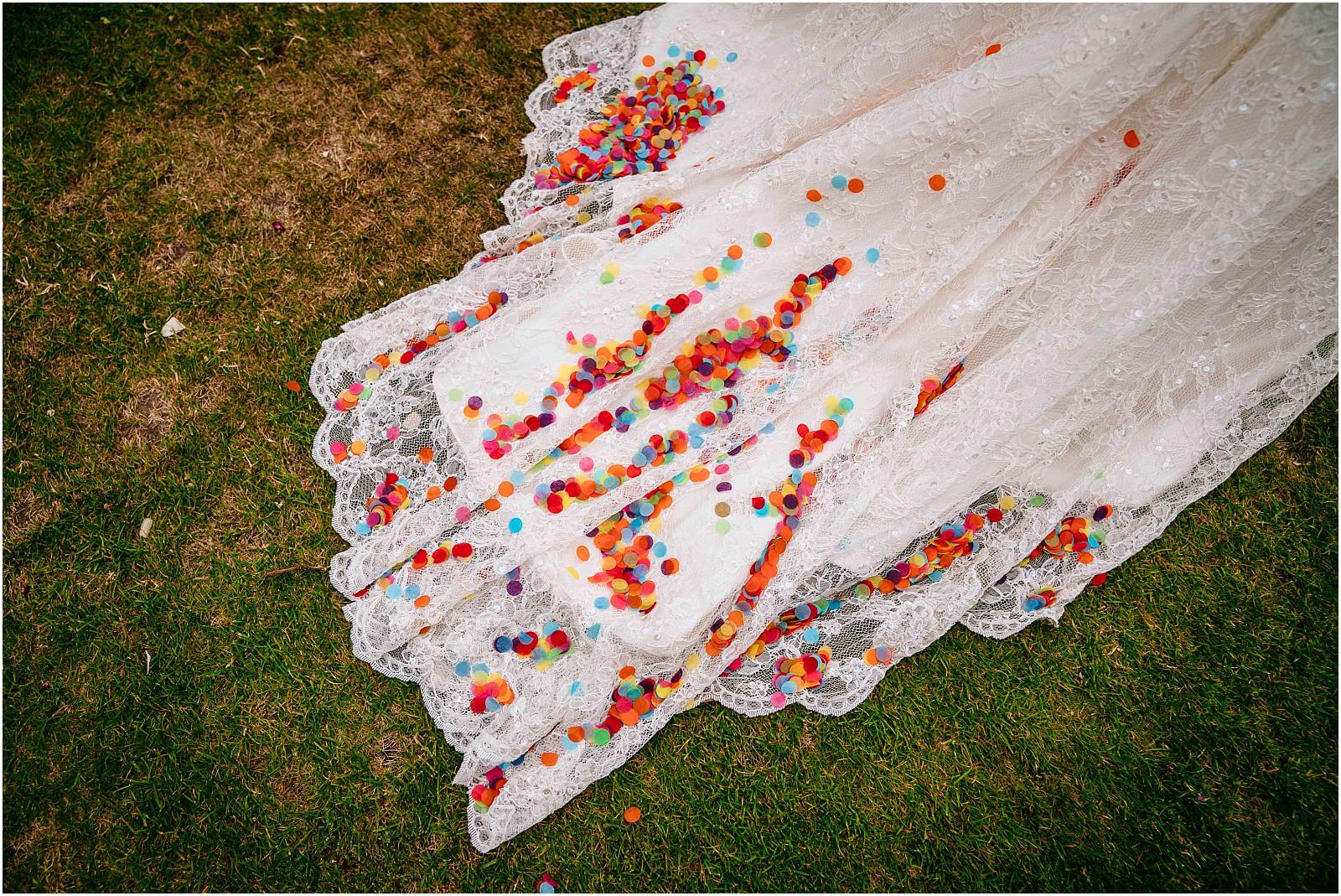 rainbow confetti on wedding dress