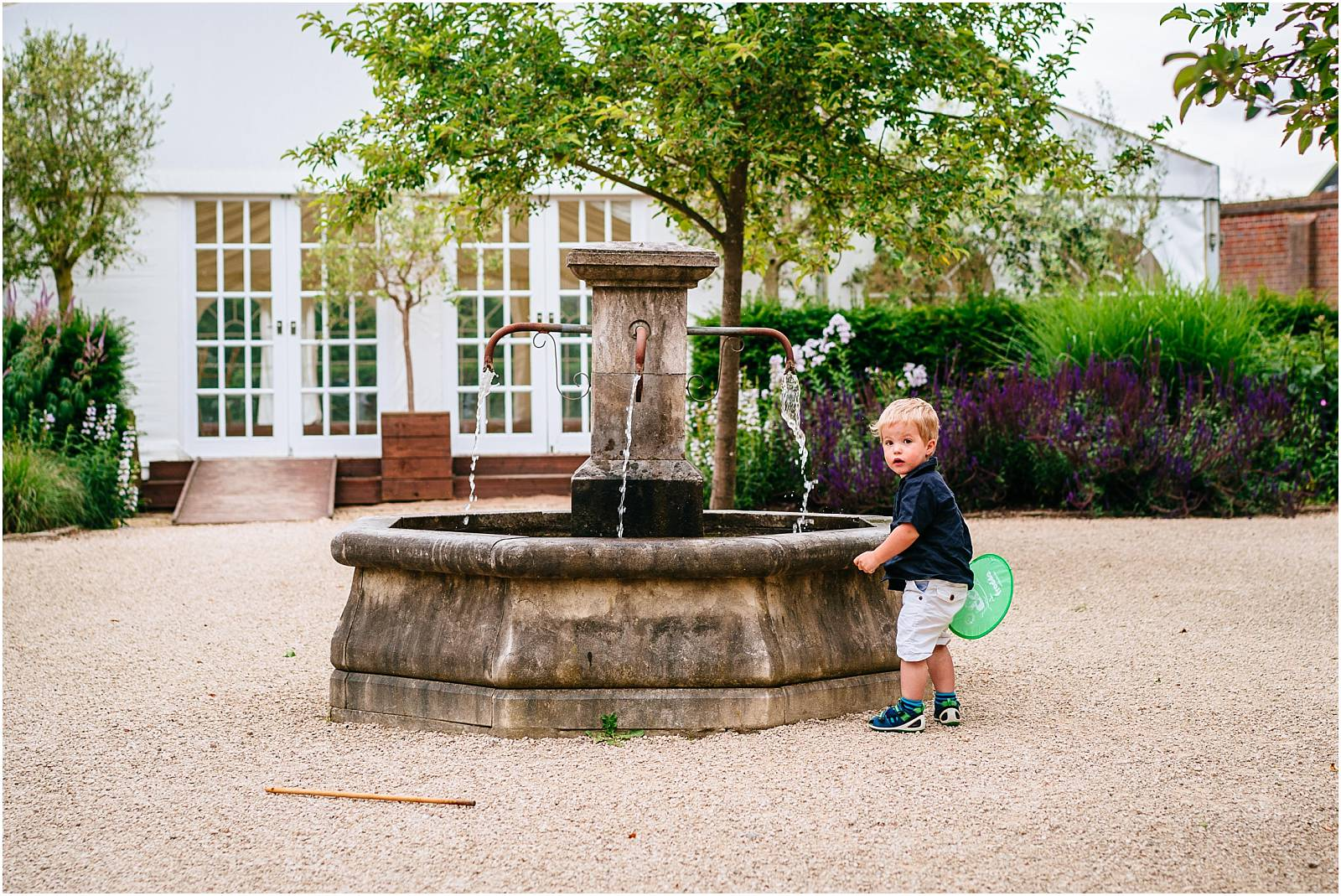 cute boy and fountain at micklefield hall