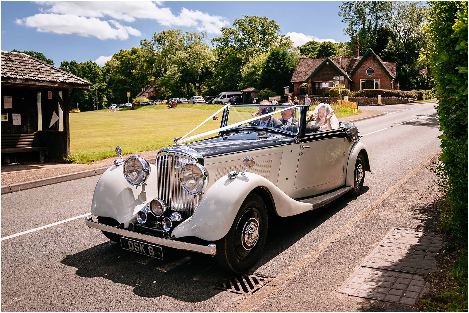 bride arriving at church in surrey in vintage car