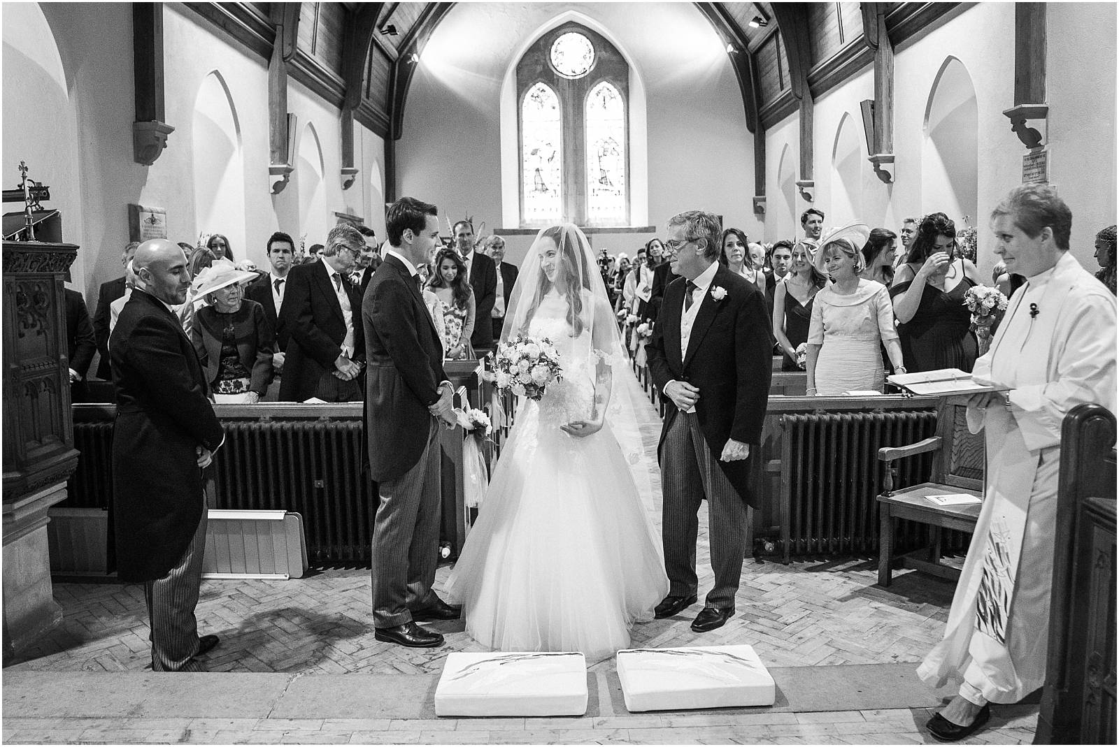 meeting groom at the front of the church