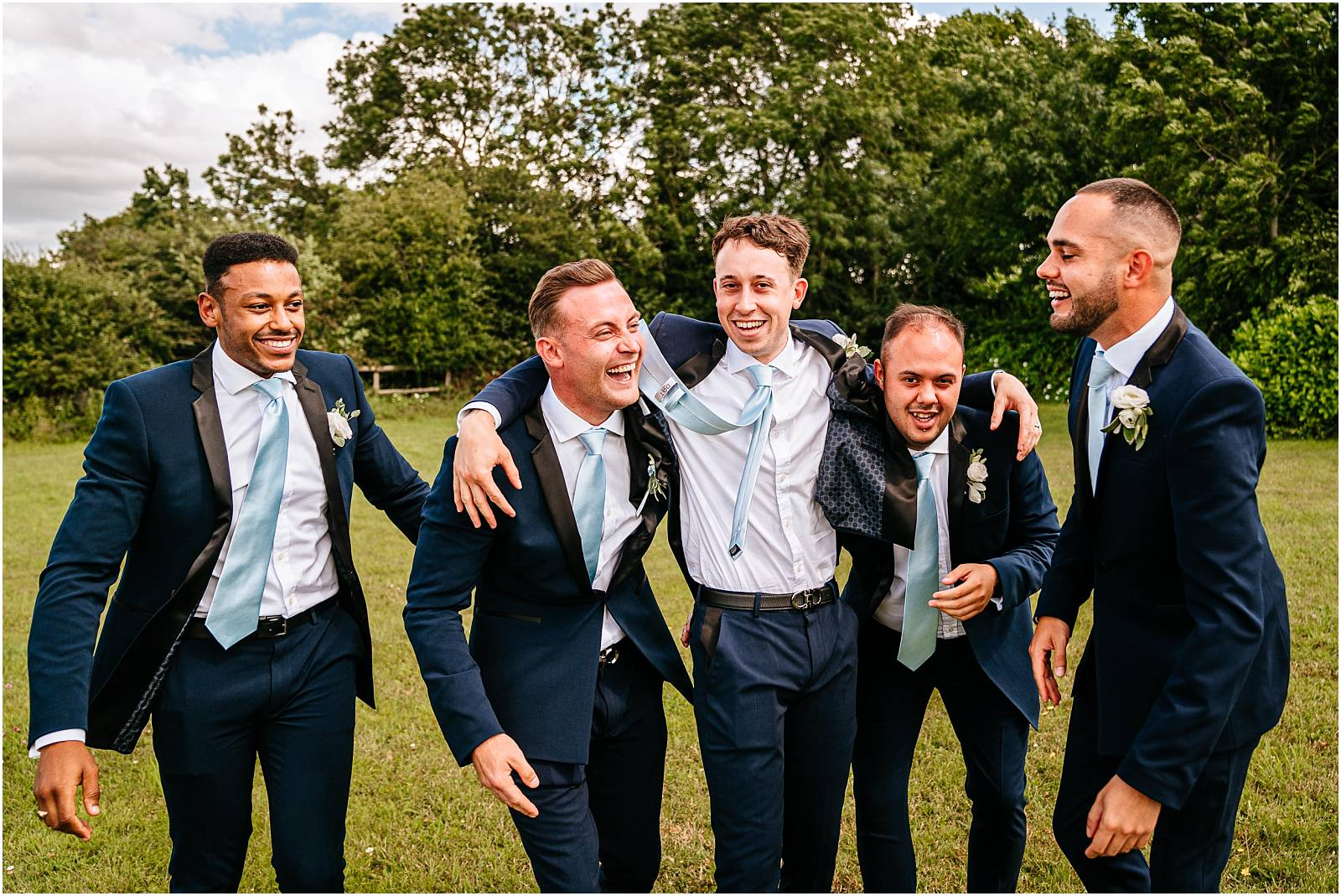 groom and his ushers groomsmen having fun