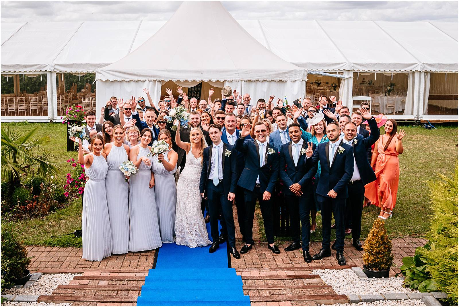 whole wedding shot in front of marquee at zinnia gardens surrey