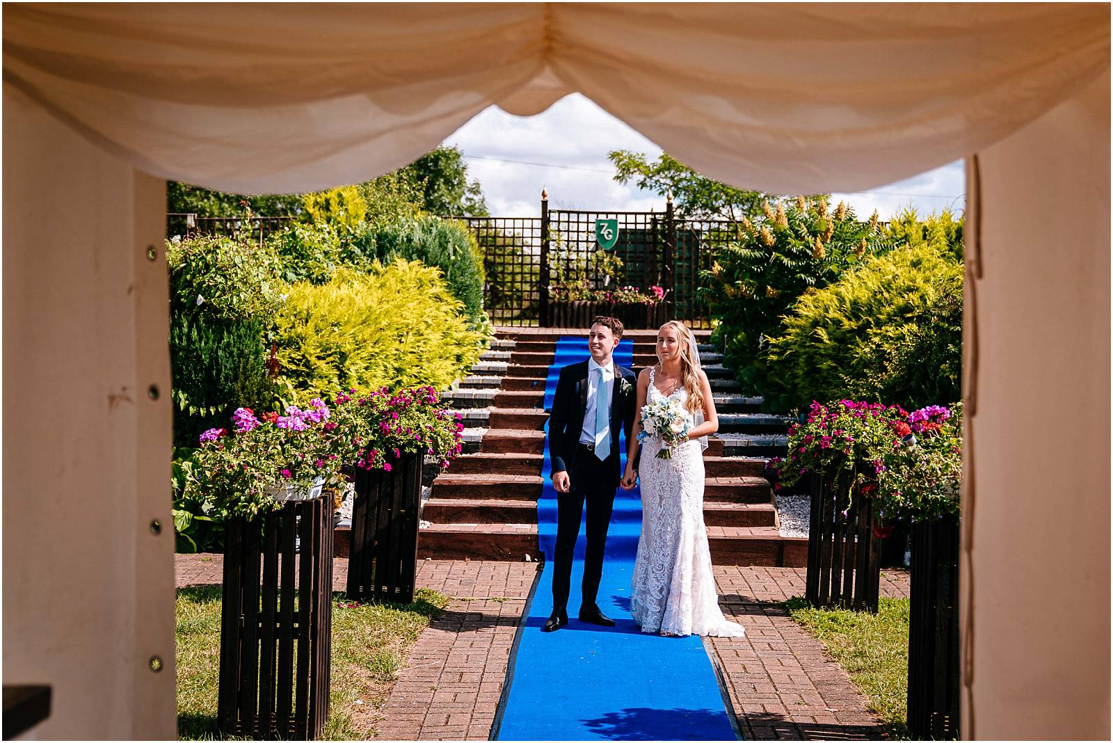 bride and groom wait to be called into their wedding reception marquee