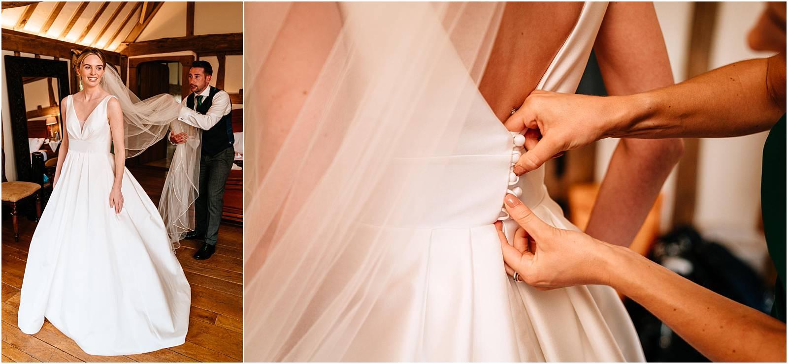 getting bride into wedding dress