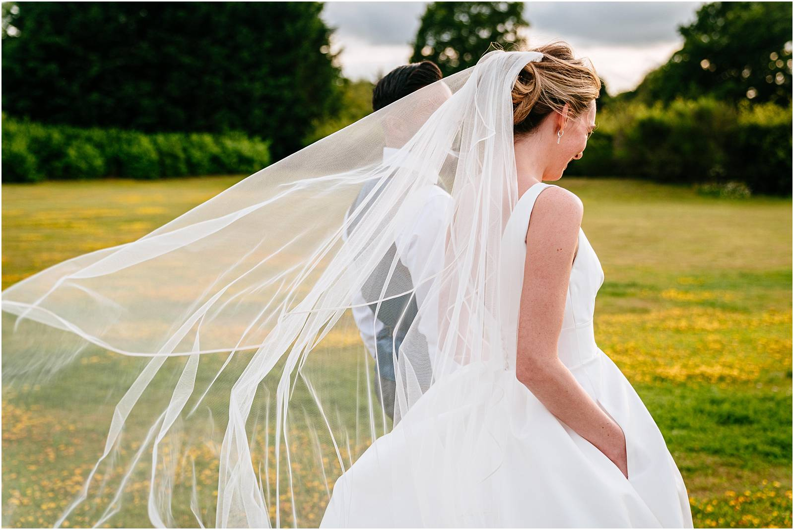 bride in suzanne neville dress