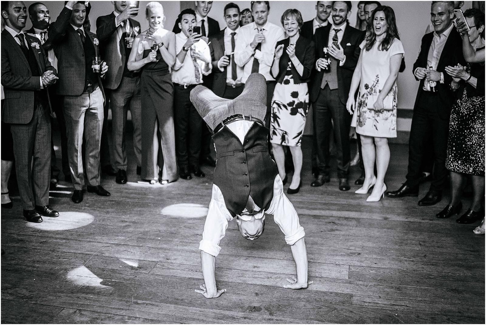 groom doing back flip