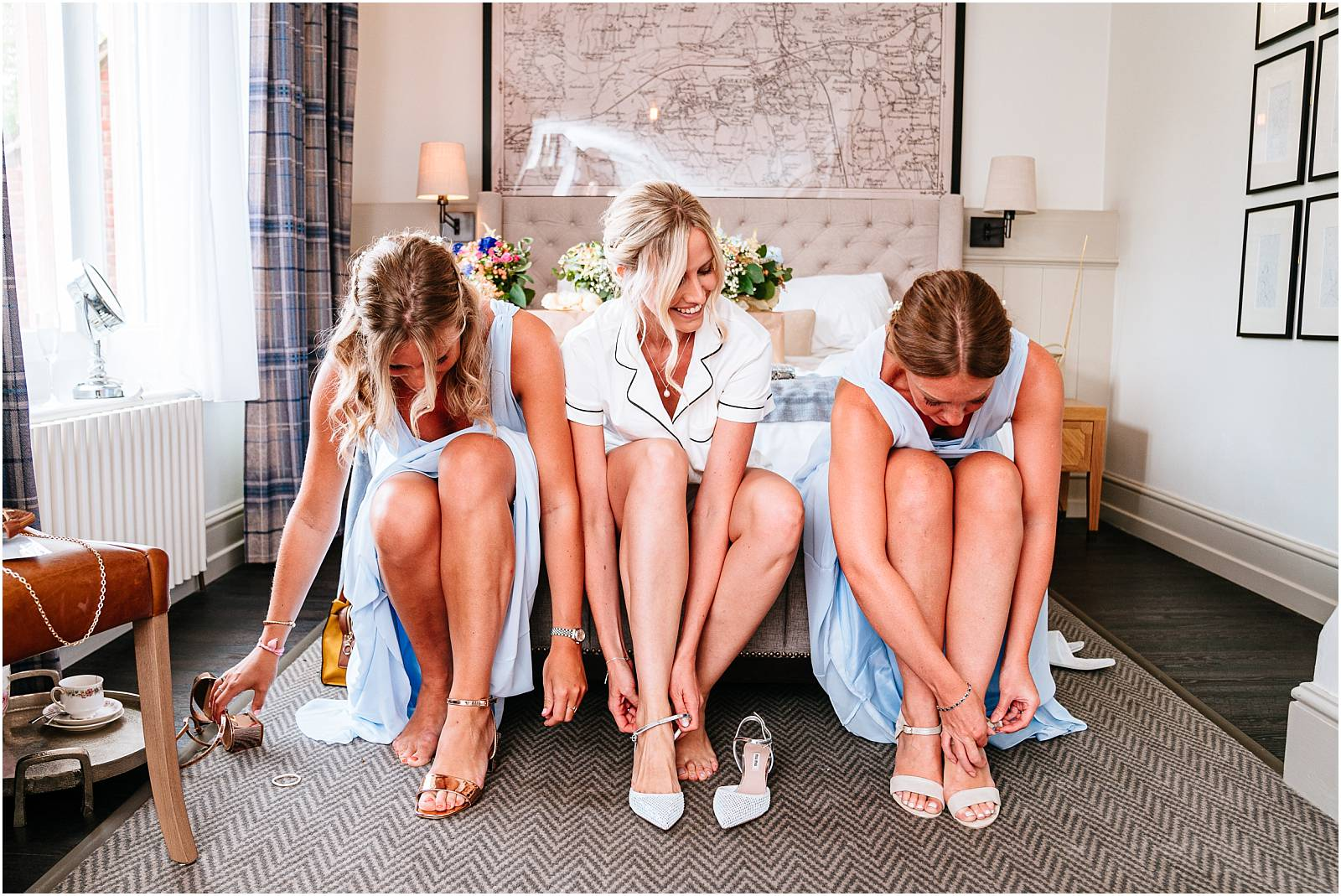 bridesmaids putting wedding shoes on