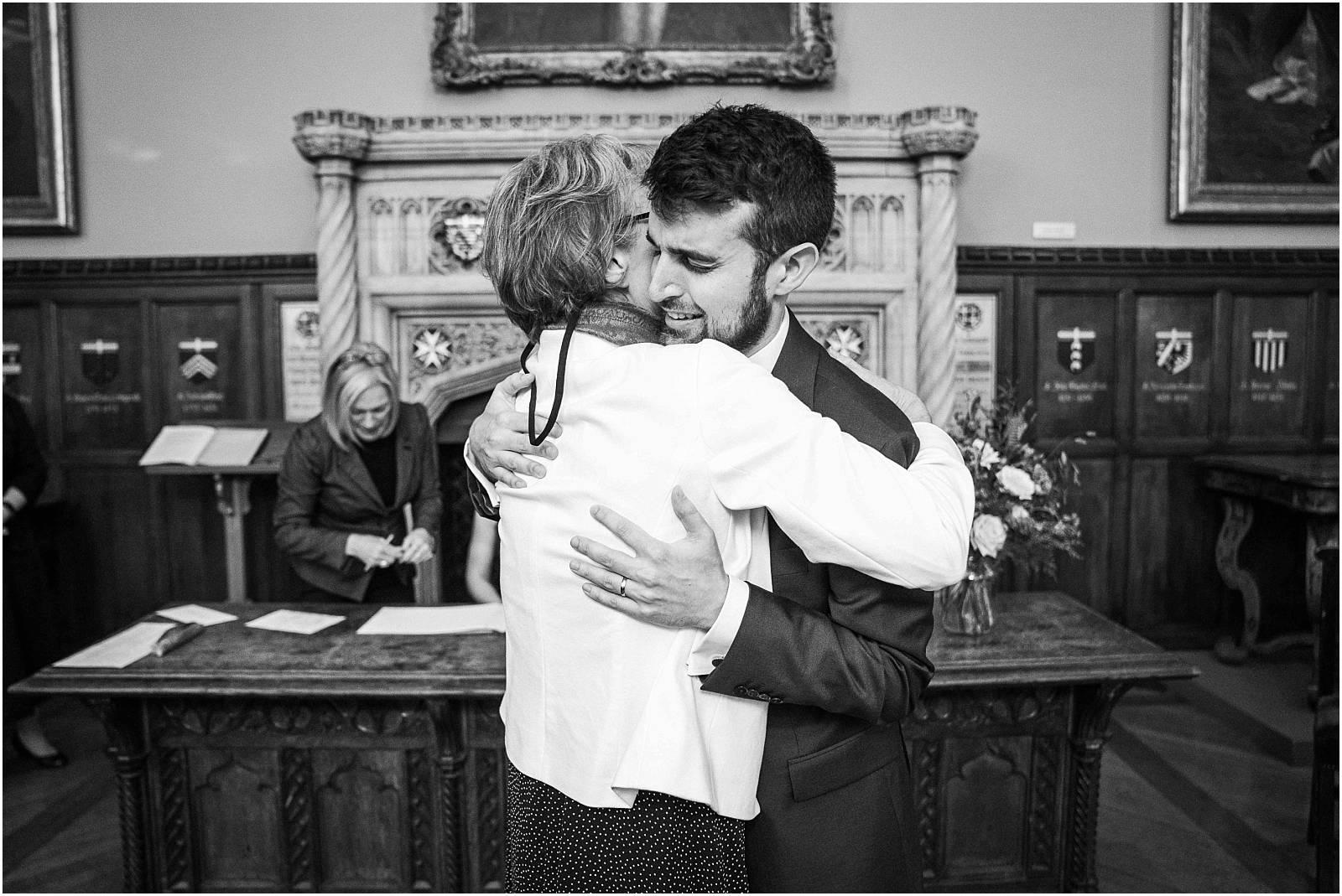 groom hugs mum