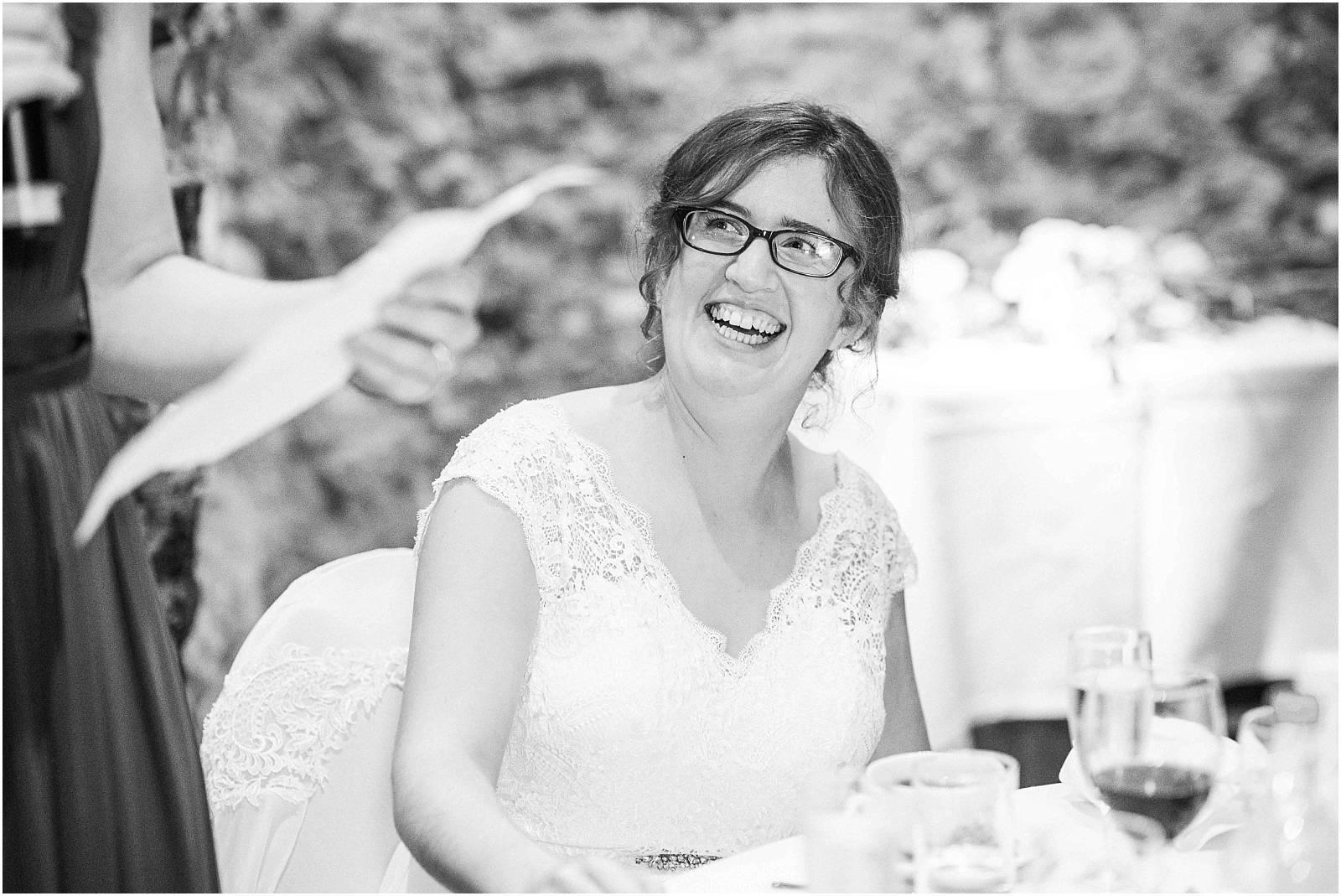 bride enjoying wedding speeches