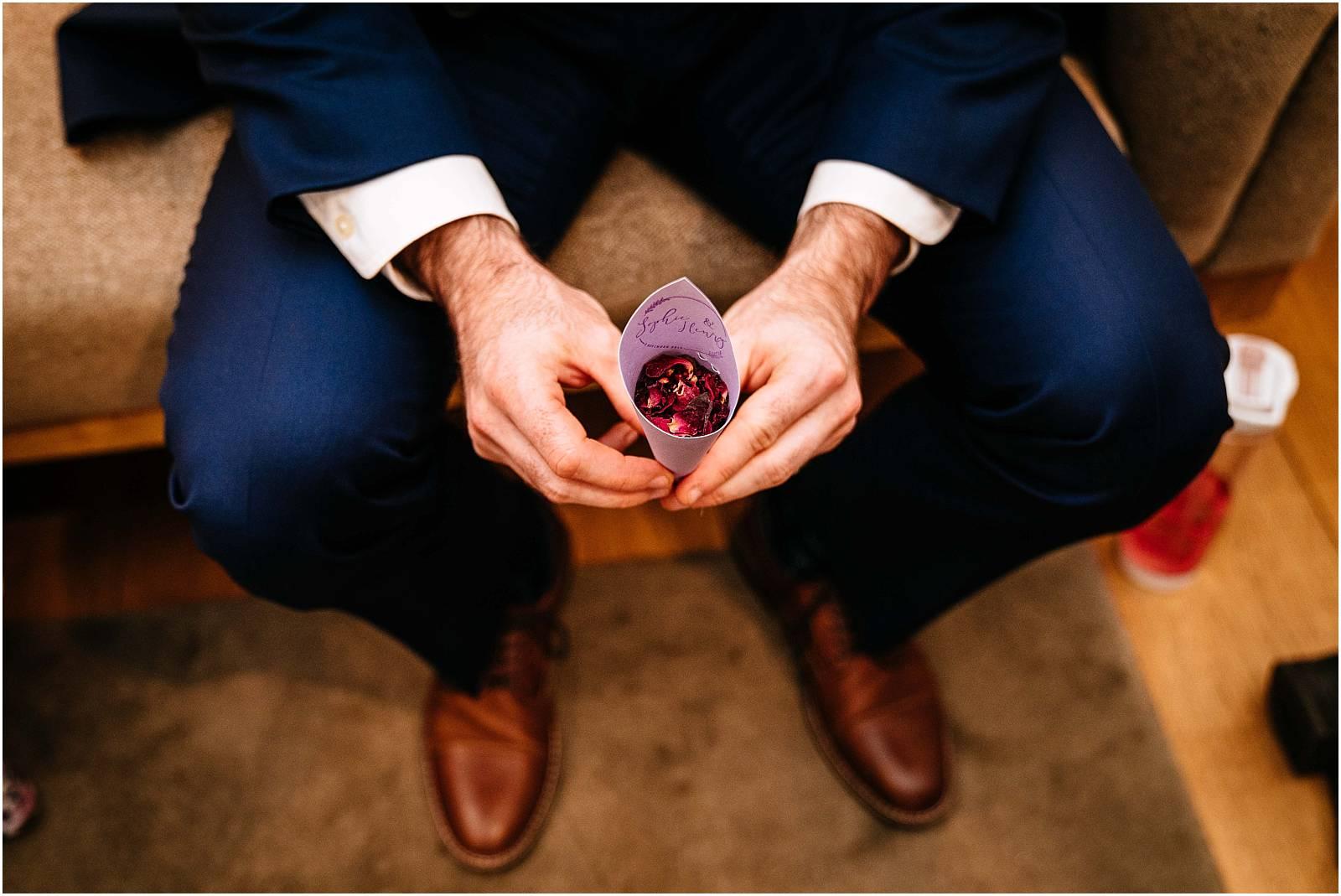 bridesman holding confetti
