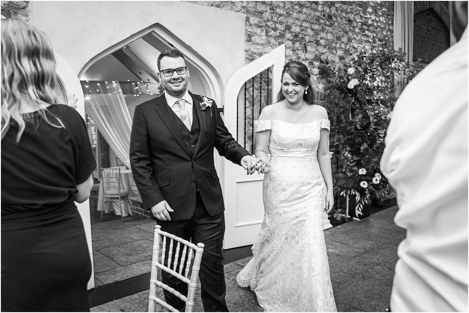 bride and groom entering farbridge for their wedding meal