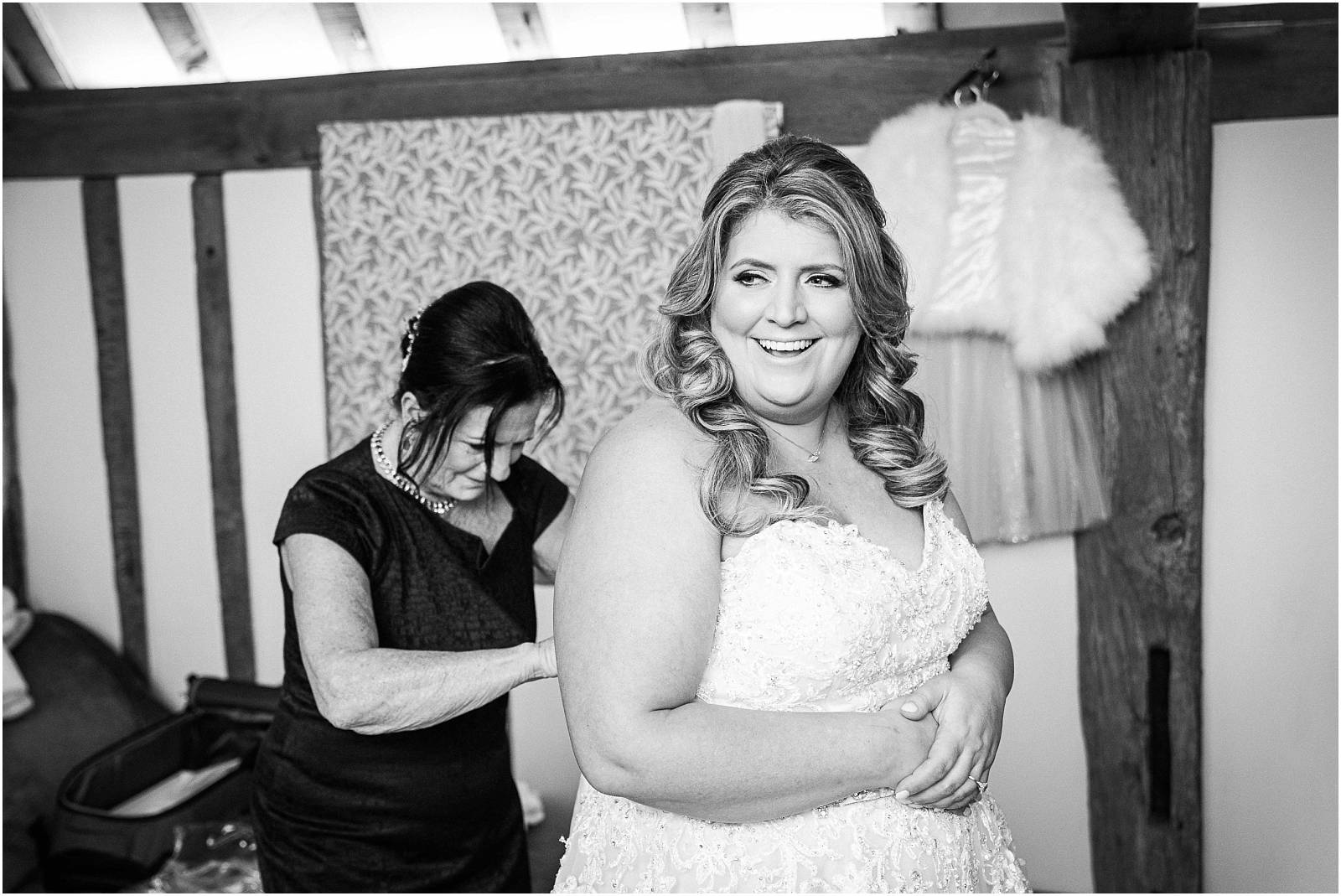 bride getting into weddingdress
