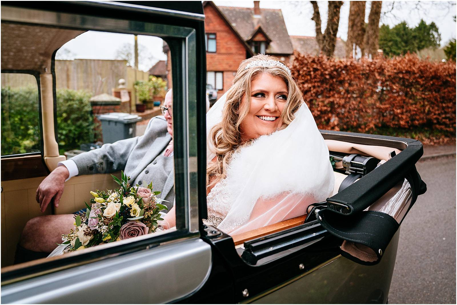 bride arrives at medstead church wedding in vintage car