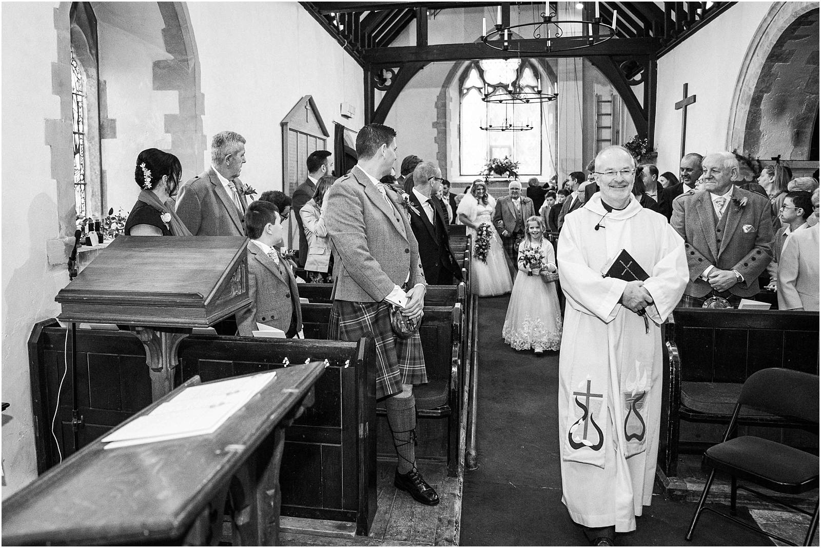 bride walks down aisle of st andrews medstead
