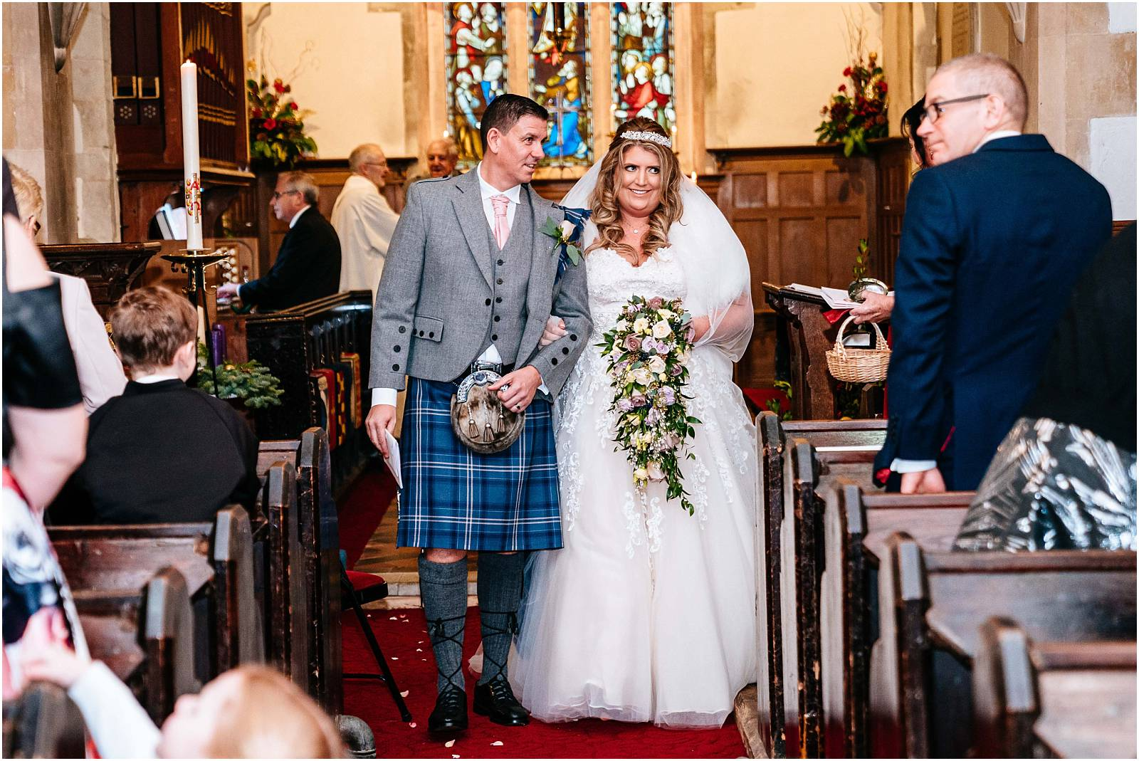 bride and groom walk back down aisle at st andrews church wedding