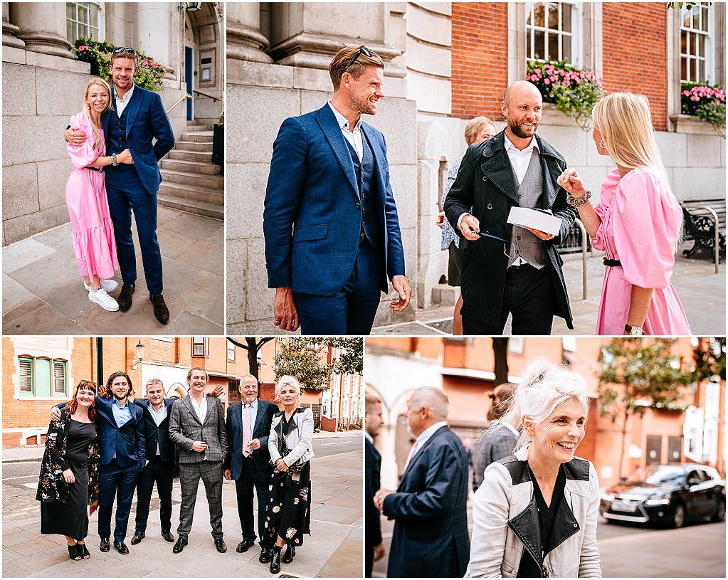 Guests outside chelsea old town hall wedding