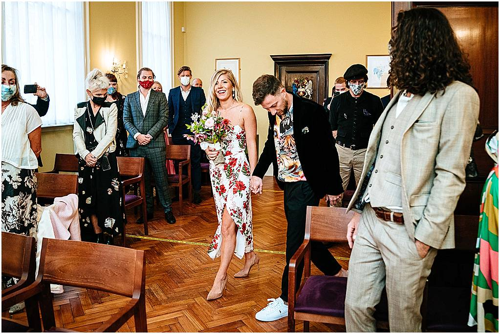bride and groom enter chelsea old town hall wedding
