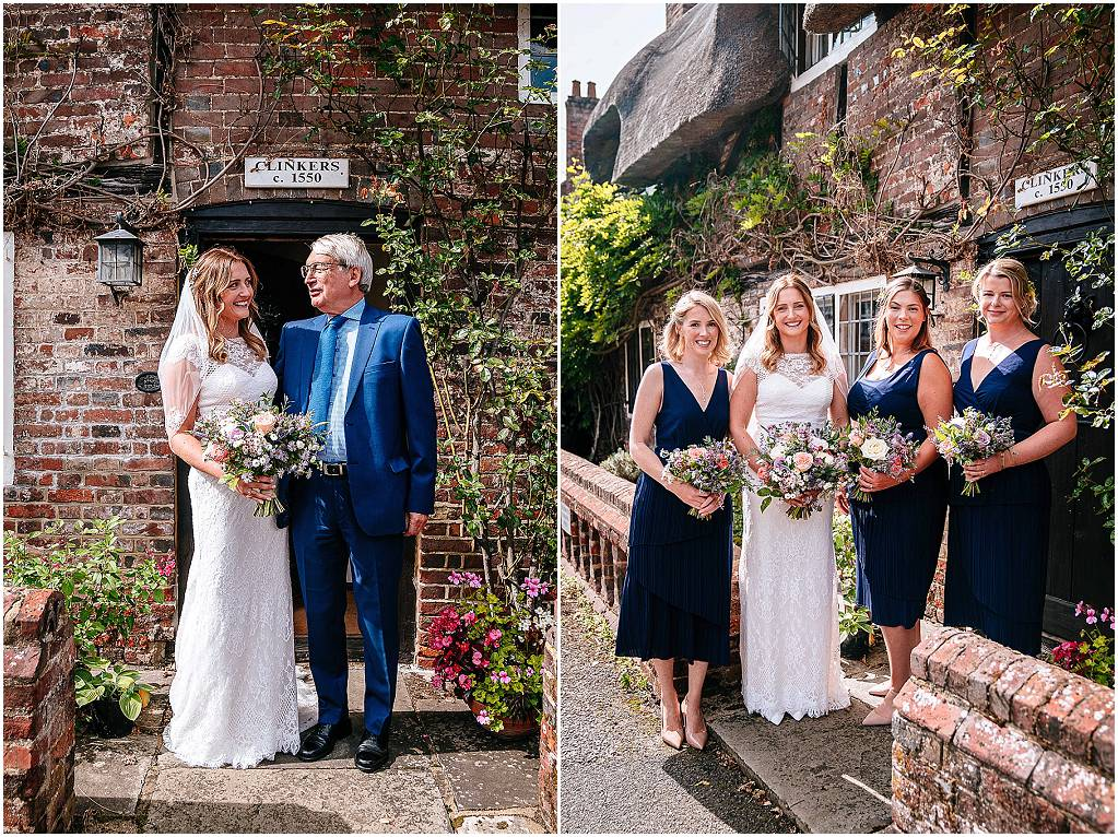 bride and bridesmaid outside cottage in chawton